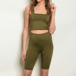 Olive green square neck crop top and biker shorts.